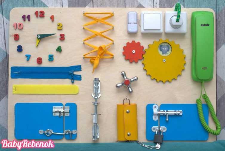 Бизиборд – развивающая доска с замочками и кнопочками для малышей своими руками