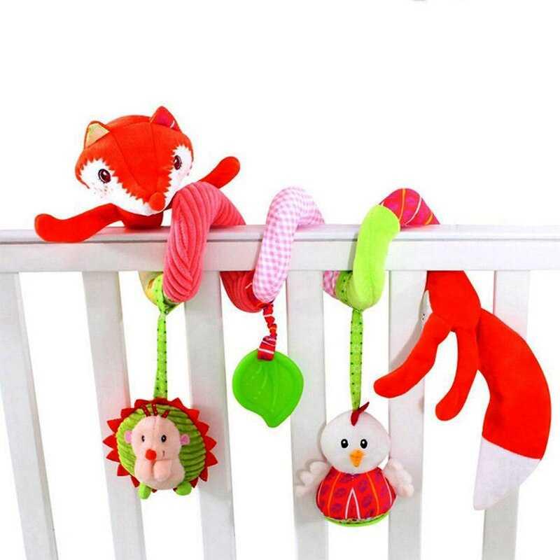 Какие игрушки и погремушки на кроватку выбрать?