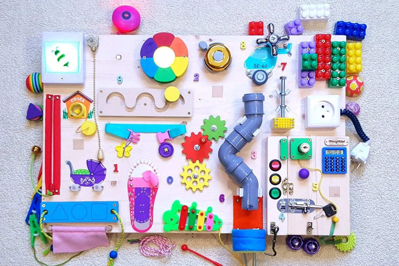 Бизиборд своими руками - 67 фото идей развивающих досок для мальчиков и девочек